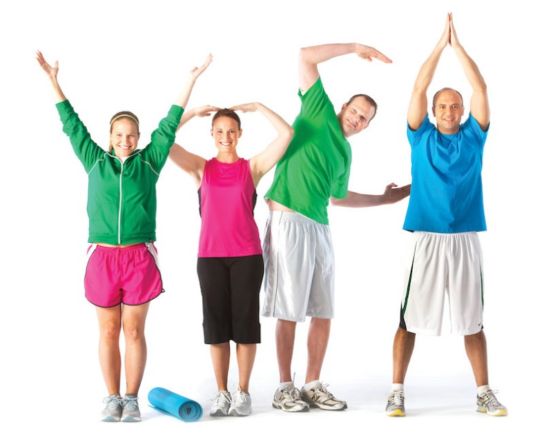 "4 people making the ""YMCA"" gestures with their arms"